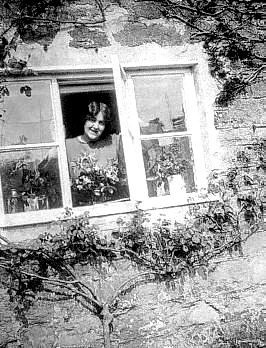 Winifred looking out of a window c1931